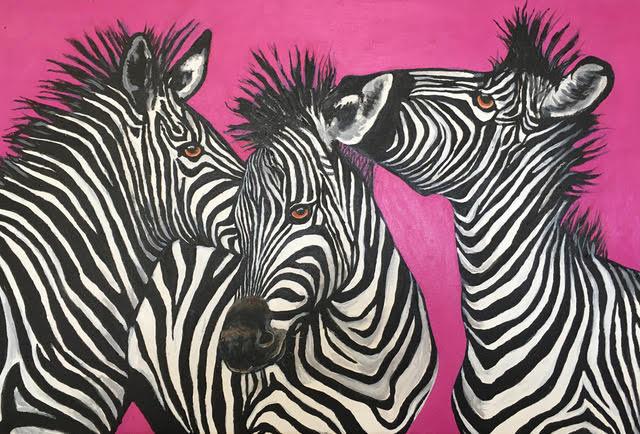 three zebras against a pink background