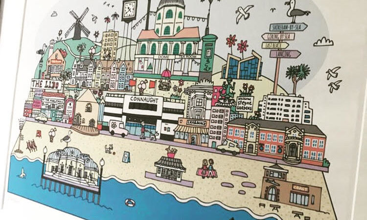A framed print of a detailed, quirky cityscape of Worthing, by Lauren Nickless.